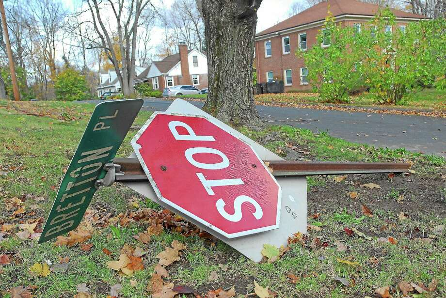 A street sign lies on the corner of Bretton Road and Bretton Place in Middletown following Hurricane Sandy in this archive photograph. Photo: File