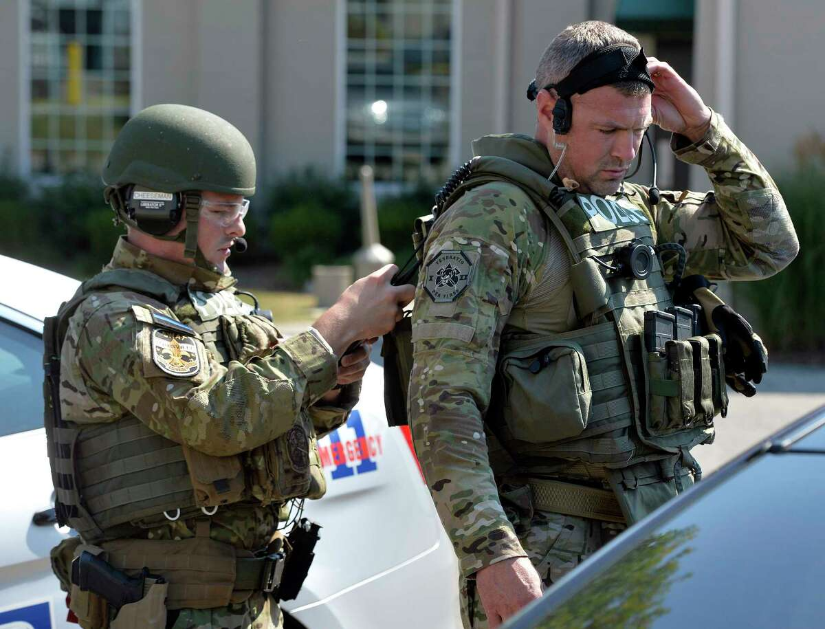 Members of the Louisville SWAT team prepare to enter Fern Creek High School to do a sweep Tuesday, Sept. 30, 2014 at Fern Creek High School in Louisville, Ky.