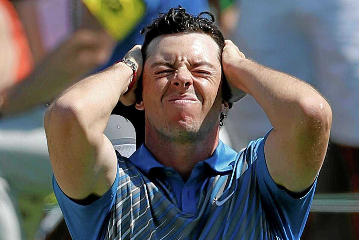 Rory McIlroy reacts after a bogey on the 18th hole at the Memorial in Dublin, Ohio, on Friday.