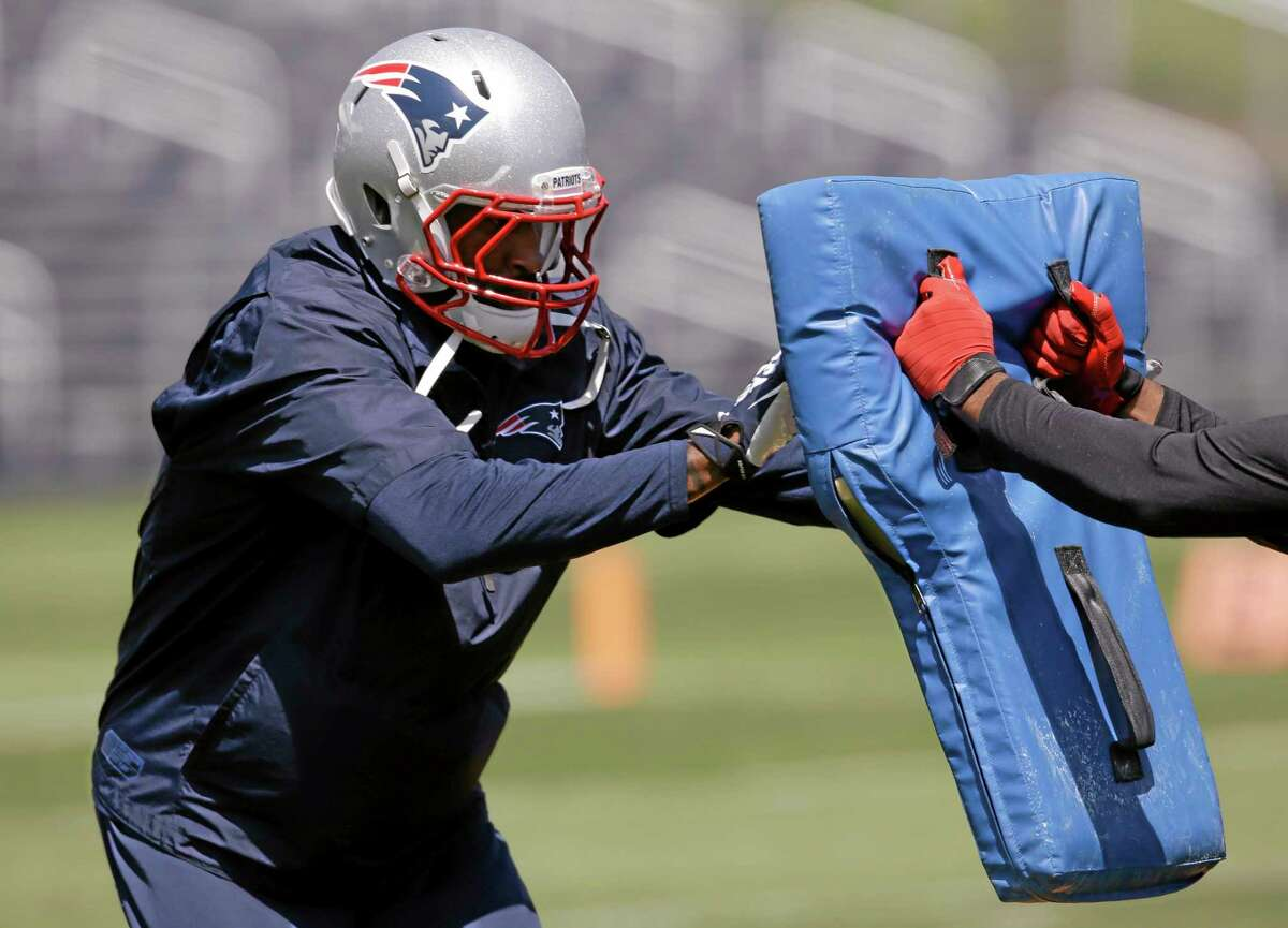 New England Patriots cornerback Darrelle Revis works on a drill during an organized team activity at the team's facility Friday in Foxborough, Mass.