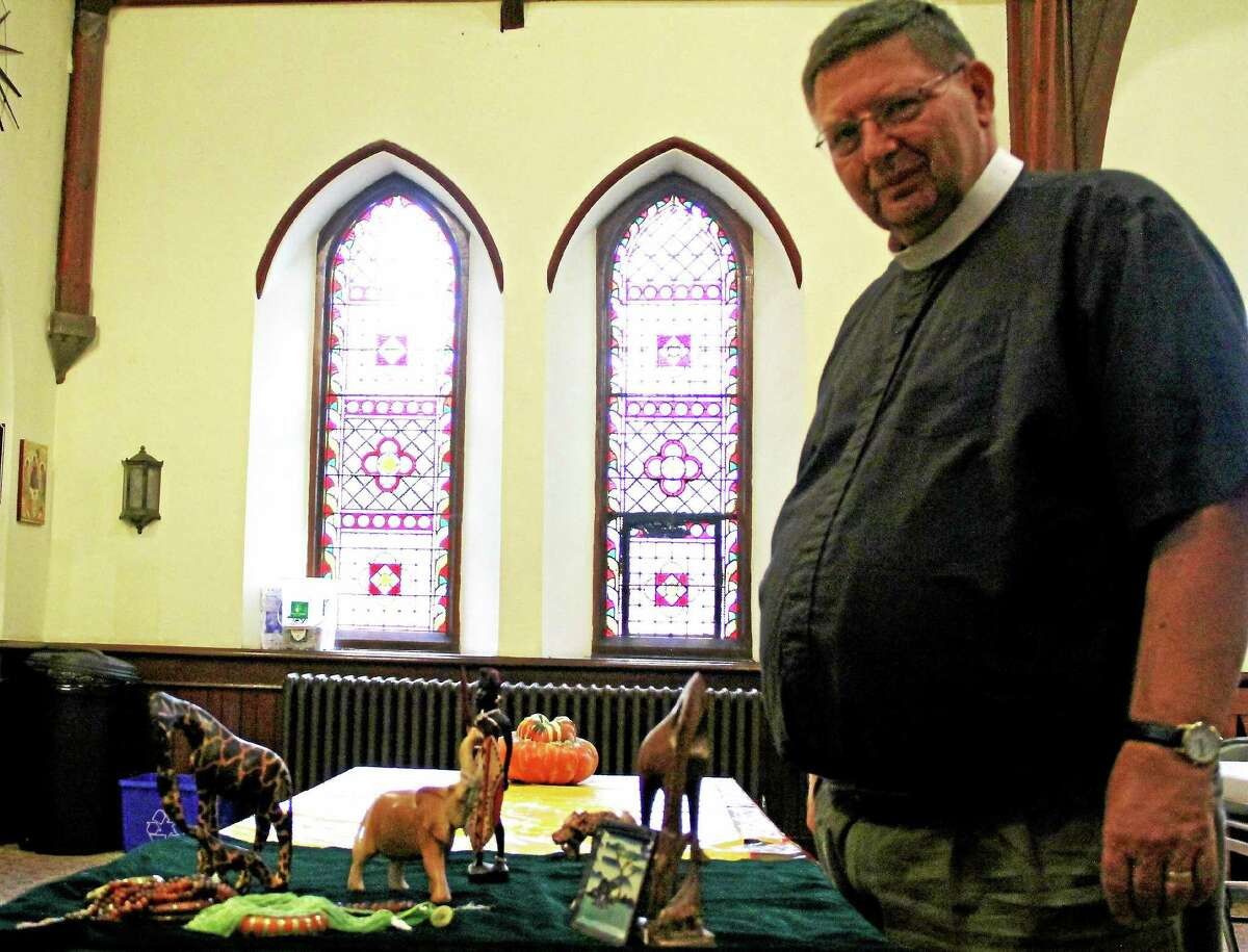 Trinity Episcopal Church Pastor Steven Ling shows some of the jewelry and wood carvings to be sold Oct. 4 and after services on Sundays at the church at 345 Main. St. The proceeds will benefit African Team Ministries serving the Churches of East Africa.