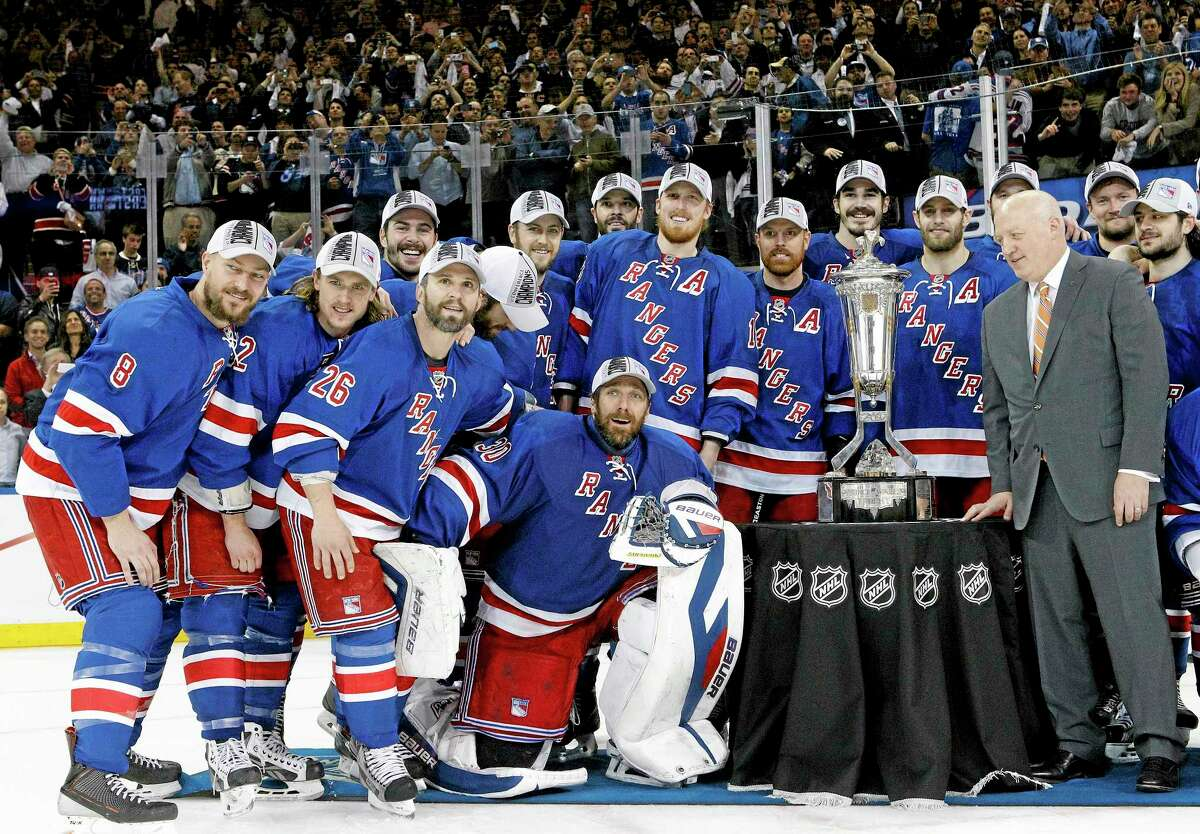 The Rangers pose for a photo with the Prince of Wales Trophy after beating the Montreal Canadiens 1-0 in Game 6 of the Eastern Conference finals on Thursday in New York.