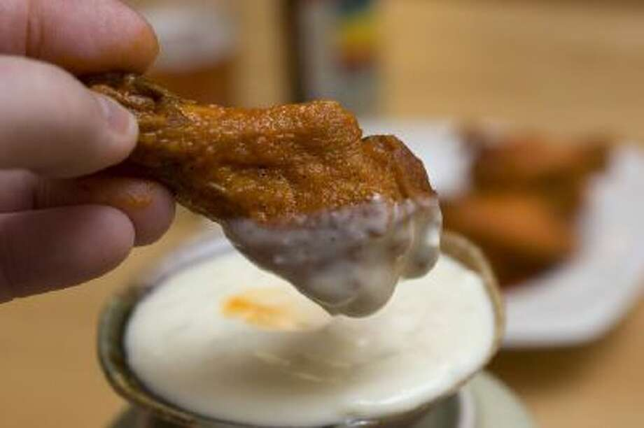 Buffalo-style Chicken Wings It's easy to bring this sports bar mainstay into your living room for the next game day.
