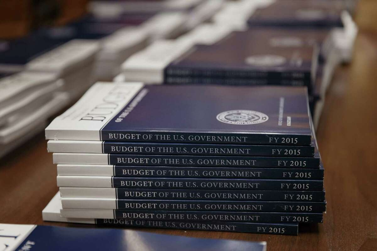 In this March 4, 2014, file photo, copies of President Barack Obama's proposed budget for fiscal 2015 are set out for distribution by the Senate Budget Committee, on Capitol Hill in Washington.