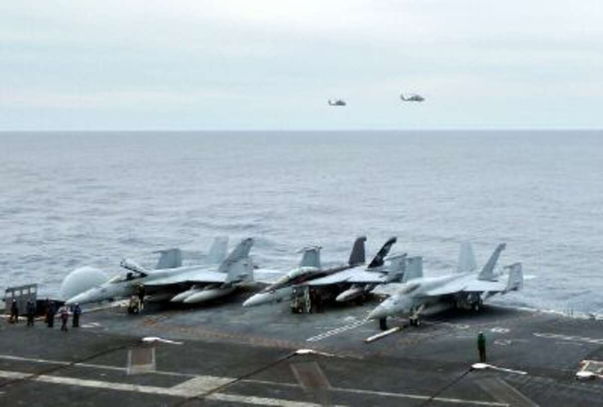 U.S. fighter jets on the USS George Washington await launch in October as the aircraft carrier patrols the South China Sea.