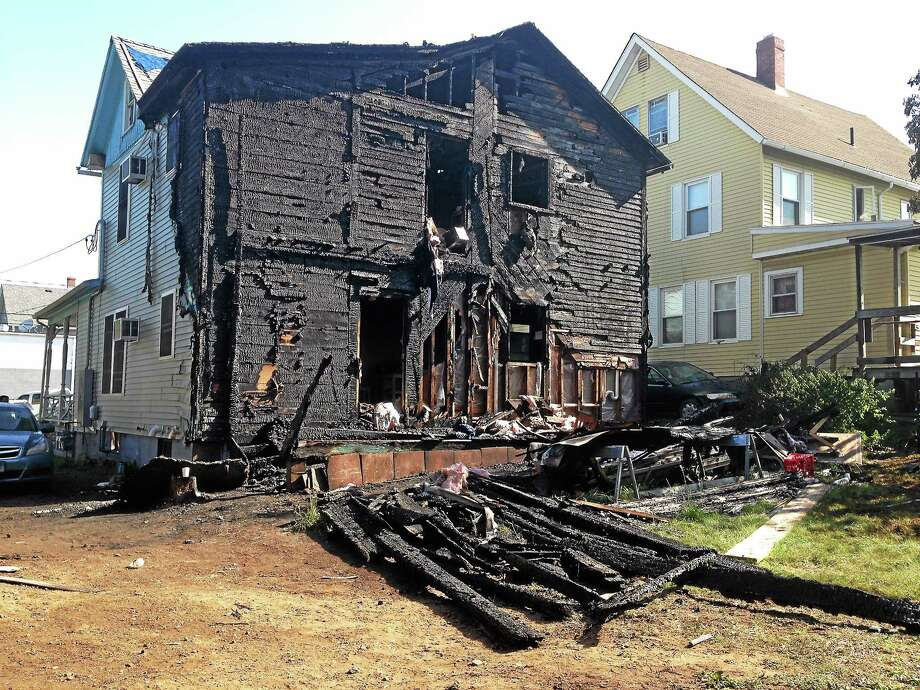 The back of 21 Cooley Ave. in Middletown after an early morning fire Friday ignited a propane tank. Photo: Kaitlyn Schroyer — The Middletown Press
