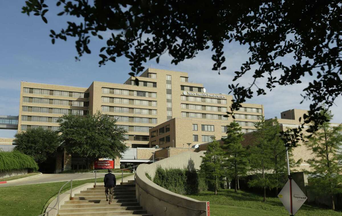 A man walks up the stairway leading to the Texas Health Presbyterian Hospital in Dallas, Tuesday, Sept. 30, 2014. A patient in the hospital is showing signs of the Ebola virus and is being kept in strict isolation with test results pending, hospital officials said Monday.