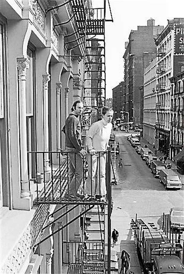 FILE - In this March 17, 1980, file photo, Stan and Julie Patz stand on the second-floor fire escape of the of their loft in the SoHo neighborhood of New York.  Below them runs Prince Street, along which Etan, their 6-year-old son, set off to school on May 25, 1979, and has not been seen since. Pedro Hernandez, who worked in a nearby convenience store and is accused of killing Patz, told police 33 years after they boy's disappearance that he choked the 6-year-old and put the still-living boy into a plastic bag, boxed up the bag and left it on a street. Opening statements in Hernandez's trial are set for Friday, Jan. 30, 2015. (AP Photo/Marty Reichenthal, File) Photo: AP / AP