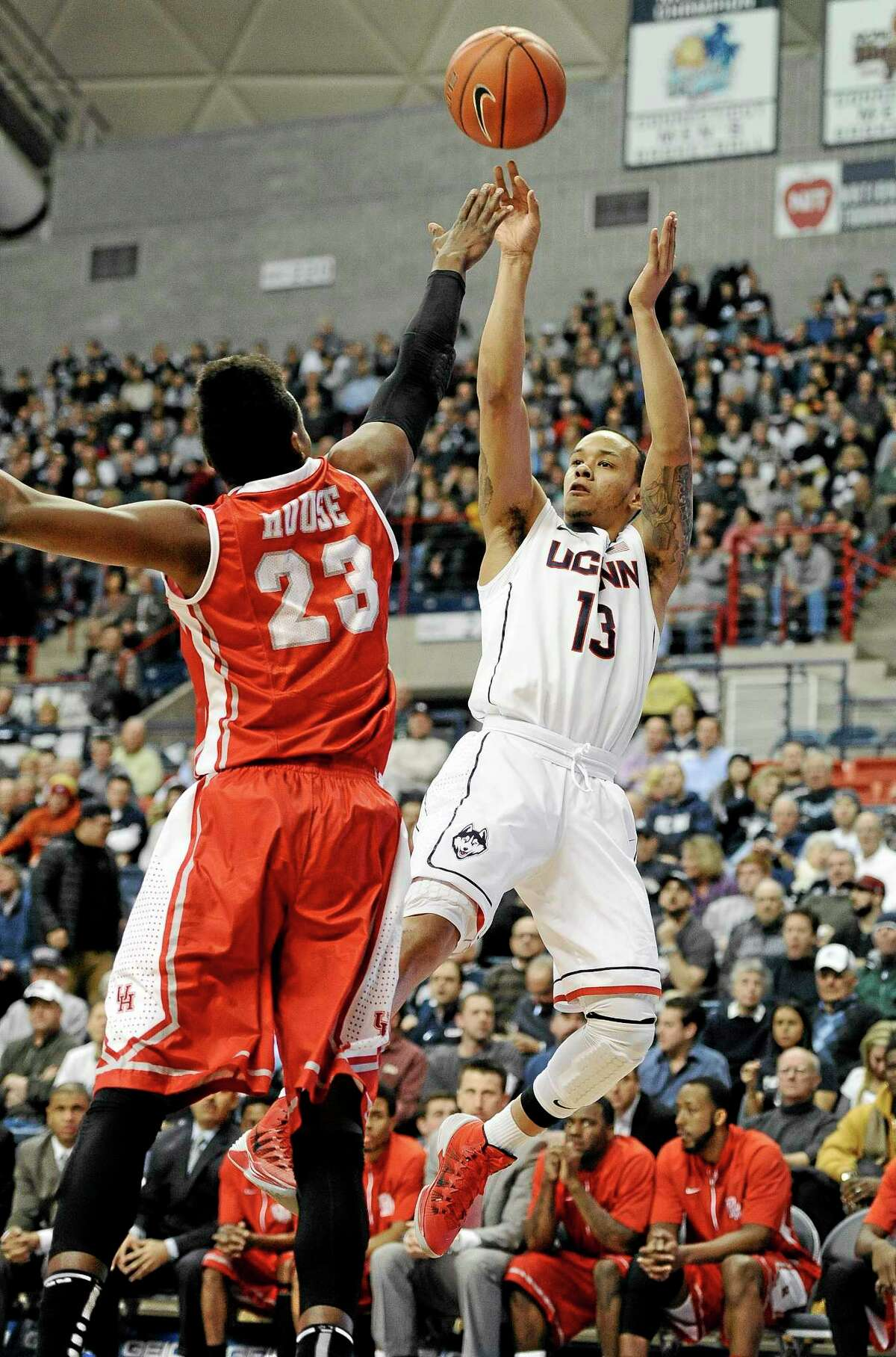 UConn's Shabazz Napier shoots over Houston's Danuel House during the first half of Thursday's game in Storrs.