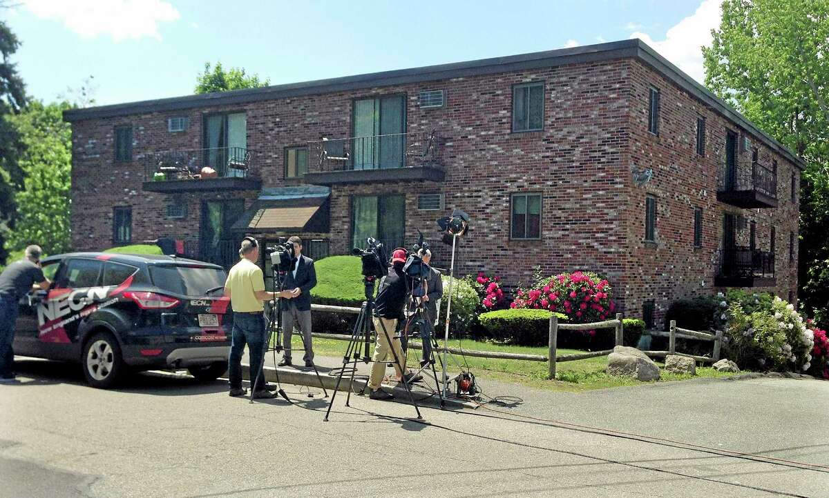 Television reporters stand outside an apartment building where Khairullozhon Matanov, 23, was arrested shortly after 5 a.m., Friday, May 30, 2014, in Quincy, Mass. Matanov, a friend of the 2013 Boston Marathon bombing suspectss, faces federal charges he destroyed, altered and falsified records, and made false statements to obstruct the investigation into the bombings. Matanov is a legal resident of the U.S. originally from Kyrgyzstan. (AP Photo/Rodrique Ngowi)