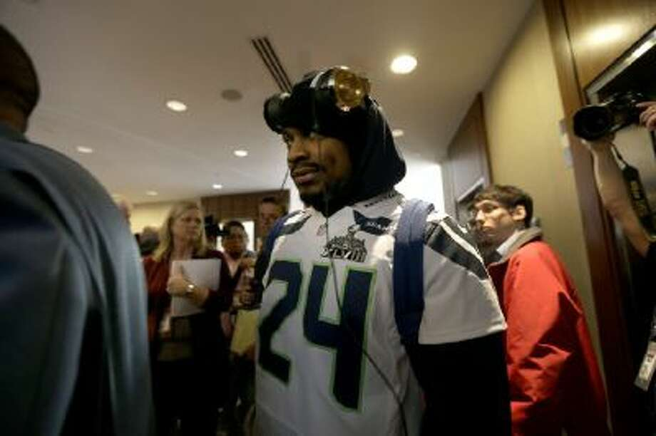 Seattle Seahawks running back Marshawn Lynch walks through an area where a media availability was being held Wednesday in Jersey City, N.J.