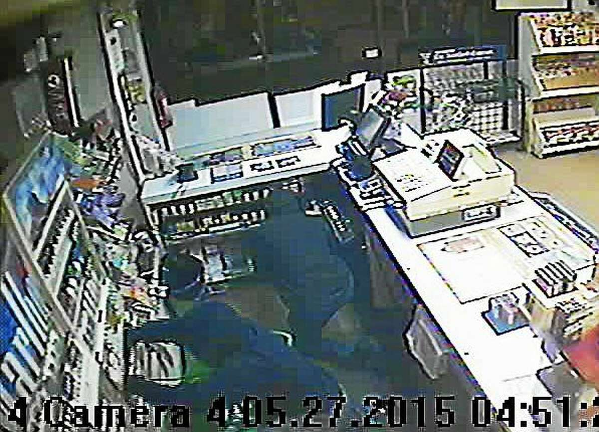 Two unidentified men in hooded sweatshirts burglarized the Mmart on Newfield Street in Middletown, police say.