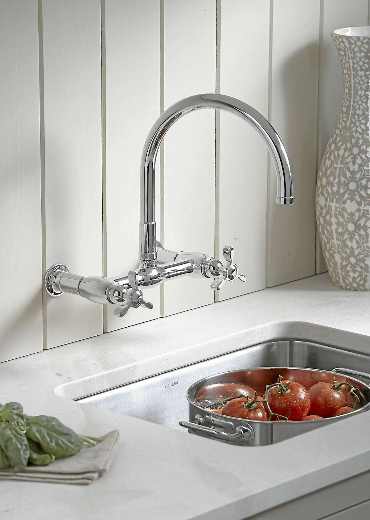 SCRIPPS HOWARD NEWS SERVICE ¬ New bridge faucets are a modern take off of the original design, and can be wall mounted or deck mounted right on the sink.