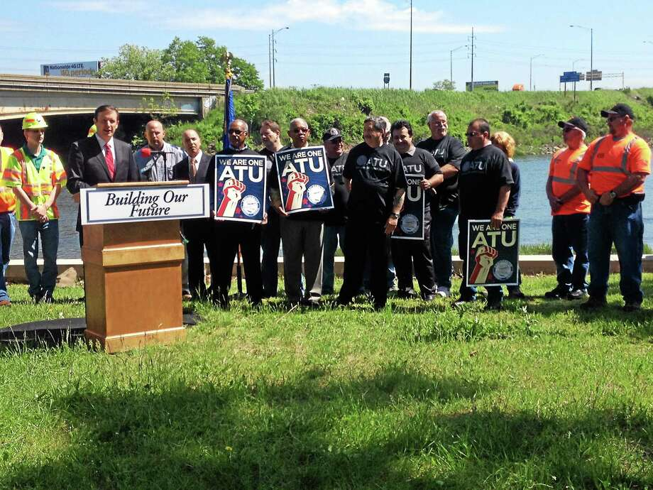 U.S. Sen. Chris Murphy, D-Conn., speaks at a news conference Friday in New Haven about his call for the gas tax to be raised in order to fund infrastructure projects, including bridge replacement and repair. Photo: Kristin Stoller — New Haven Register