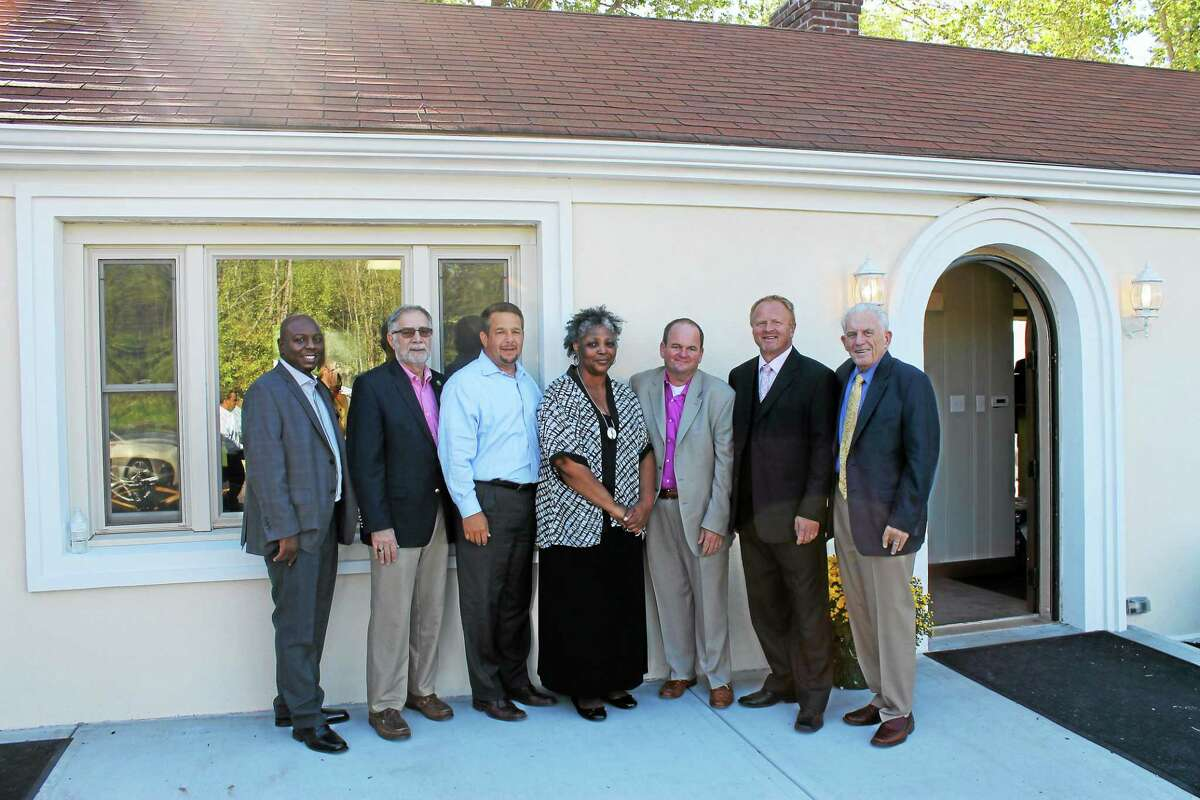 From left are Realtor Charles Pickett, Deputy Mayor of Middletown Bob Santangelo, Middlesex County Chamber of Commerce Chairman Rich Carella, Sales Associate Brenda Coleman, Innovative Properties Owner Keith Murphy, Realtor John Baran and Chamber President Larry McHugh.