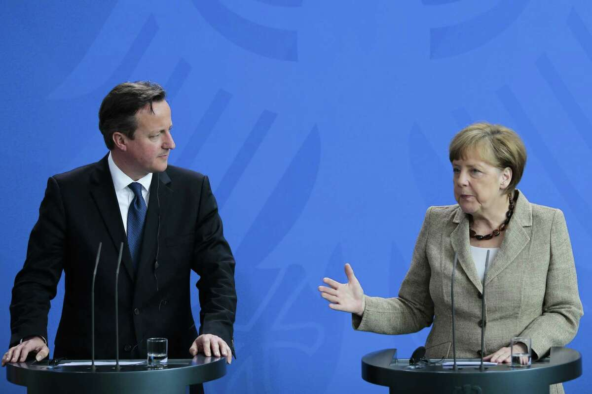 German Chancellor Angela Merkel, right, and British Prime Minister David Cameron brief the media after meeting at the chancellery in Berlin, Germany, Friday, May 29, 2015. (AP Photo/Markus Schreiber)