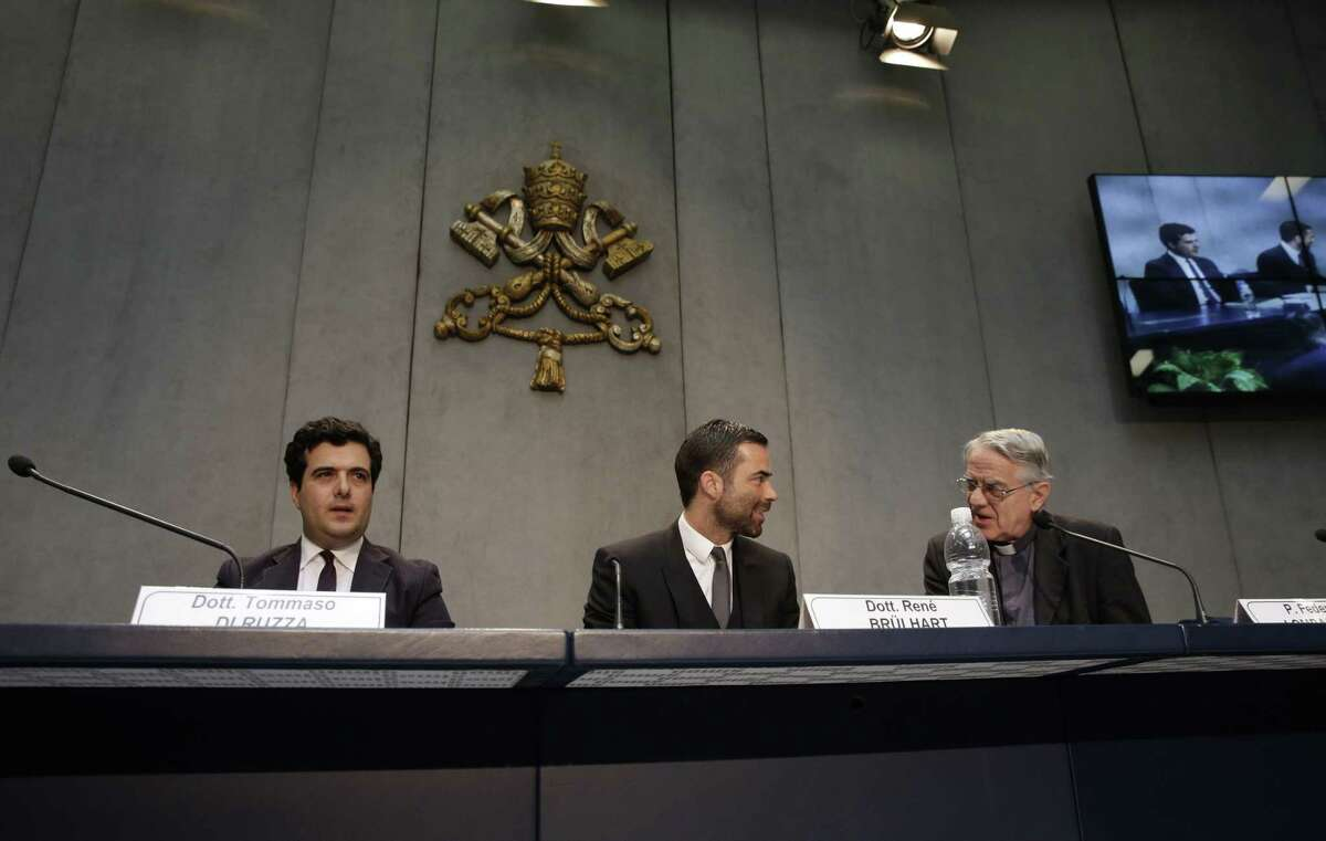 Rene Bruelhart, president of the Financial Information Authority, an institution created by Emeritus Benedict XVI in 2010 as a key part of an overall bid to clean up the Vatican's financial house to comply with international anti-money laundering and anti-terror financing norms, center, Tommaso Di Ruzza, director of the Financial Information Authority, left, and Vatican spokesperson, Father Federico Lombardi meet the press at the Vatican, Friday, May 29, 2015. The Vatican's financial watchdog agency said Friday it received 147 reports of suspicious financial transactions last year, a sign that tough new anti-money laundering norms are taking hold at its scandal-marred bank. (AP Photo/Alessandra Tarantino)