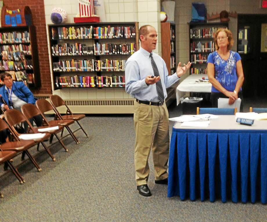 East Hampton High School School Nurse Peggy Puzzo and Athletic Director Shaun Russell discuss concussion data with education board members. Photo: Jeff Mill - The Middletown Press