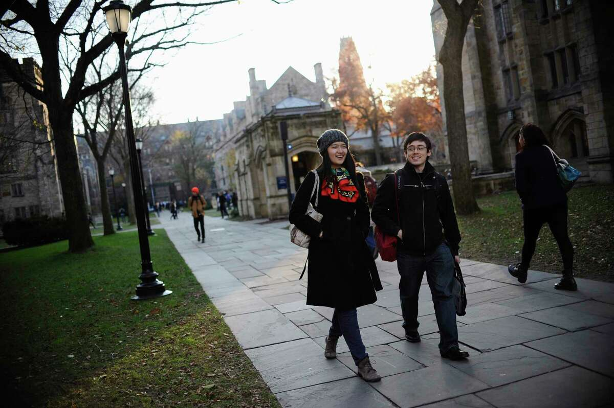 In this Nov. 20, 2014 photo, Yale University sophomore Yupei Guo, left, walks with friend Joseph Lachman on the school's campus in New Haven, Conn. With more undergraduates coming from overseas than ever, some Ivy League universities are reaching out in new ways to attract international students of more varied backgrounds -- and particularly from China, which sends more students to the U.S. than any other country.