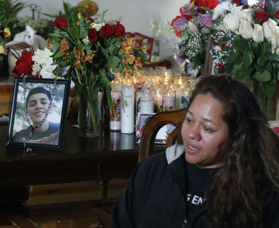 Laura Hernandez talks with reporters in her Thornton, Colo., home on Wednesday, Jan. 28, 2015, about the death of her 17-year-old daughter Jessica, who was killed after she allegedly hit and injured a Denver Police Department officer while driving a stolen vehicle early Monday in northeast Denver alleyway. Photographs of Jessica Hernandez stand on a table covered with bouquets of flowers and a display of candles at back in the family's home. (AP Photo/David Zalubowski) Photo: AP / AP