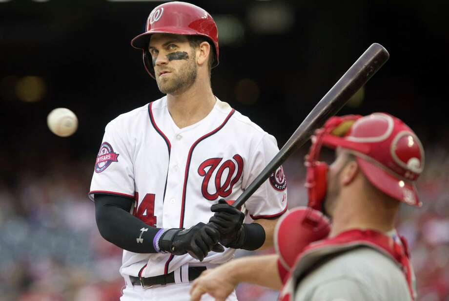 The Nationals' Bryce Harper (34) waits as the catcher returns the ball during the eighth inning on Sunday. Photo: Jacquelyn Martin — The Associated Press  / AP