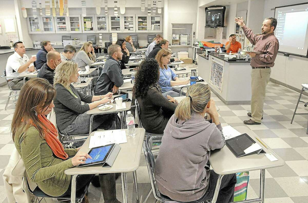 Cromwell High School administrators are pleased with how quickly students — like others across the country, as shown in this file photo — are adapting to using iPads in the classroom.