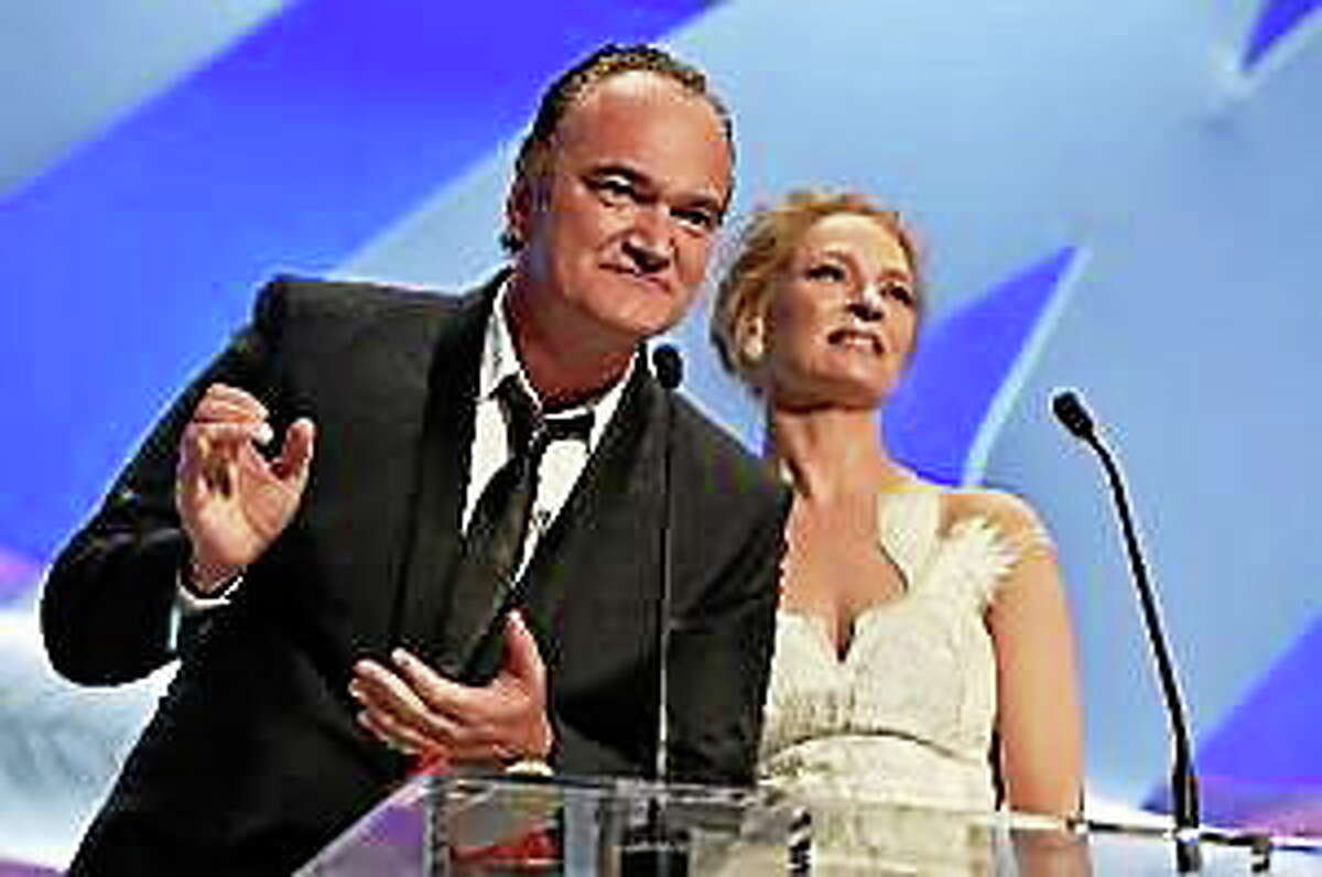 Quentin Tarantino and Uma Thurman appear on stage to give the Palme d'Or award during the Closing Ceremony at the 67th Annual Cannes Film Festival on May 24, 2014, in Cannes, France.