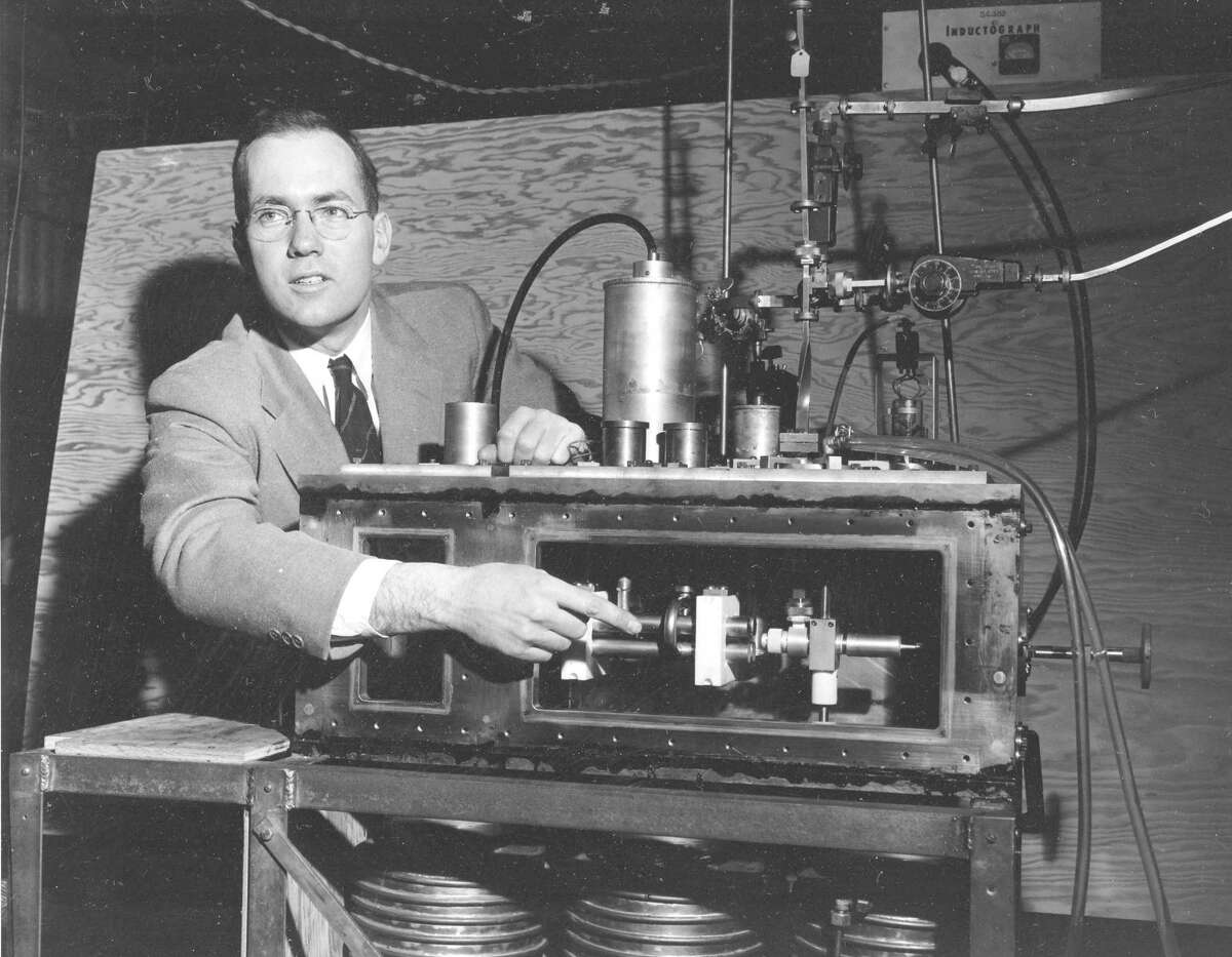 File - In this Jan. 25, 1955, file photo, Charles Hard Townes, Columbia University professor and Nobel laureate, explains his invention the maser during a news conference in New York City. Townes, who did most of the work that would make him one of three scientists to share the 1964 Nobel Prize in physics for research leading to the creation of the laser while he was a faculty member at Columbia University, has died. He was 99. Officials at the University of California, Berkeley, where Townes was a professor emeritus, said he had been in poor health before he died Tuesday, Jan. 27, 2015, on the way to an Oakland, Calif., hospital. (AP Photo/File)