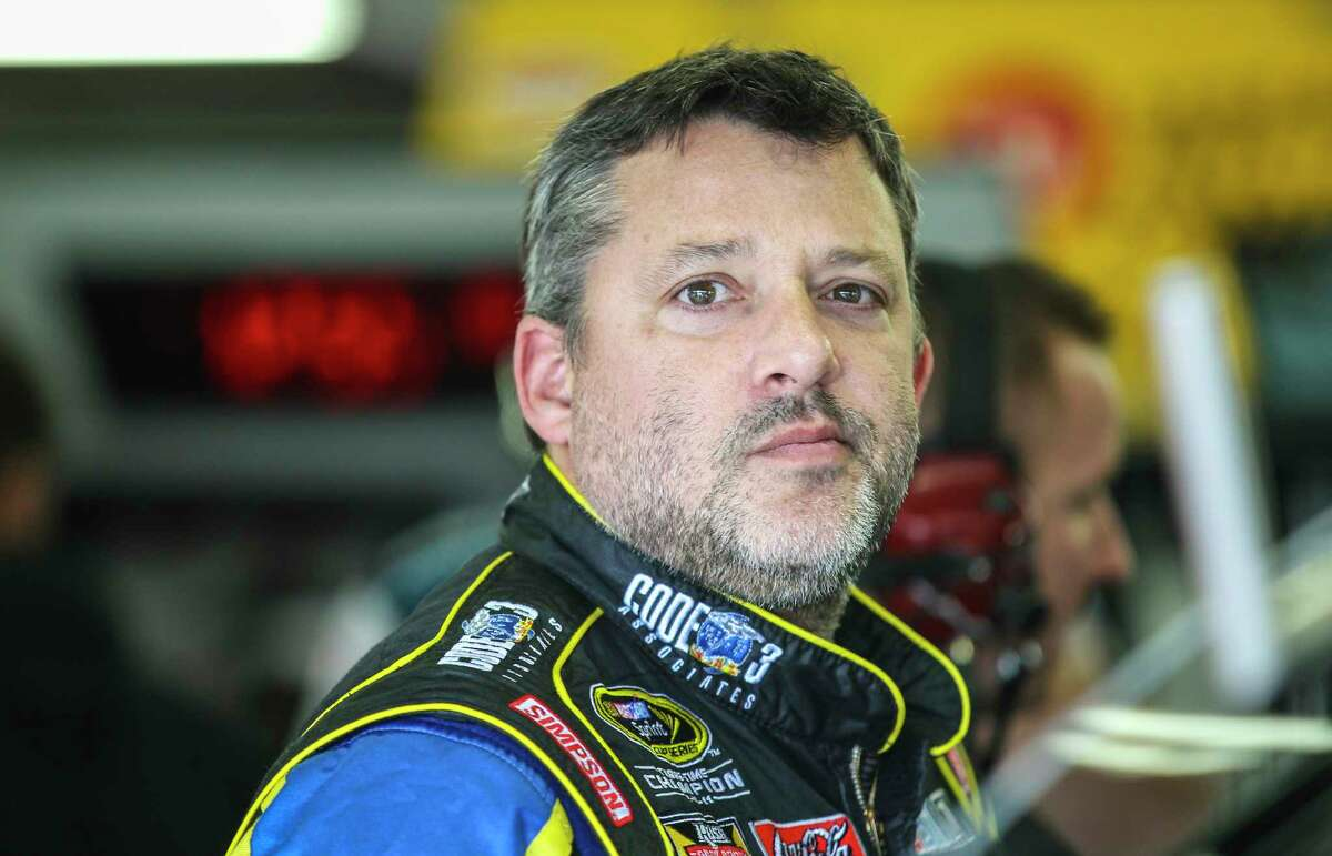 Tony Stewart waits in the garage while his car is worked on during practice for the Sunday's NASCAR Sprint Cup series race at New Hampshire Motor Speedway.