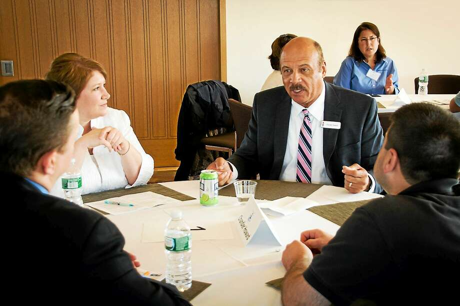 Chandler Howard, CEO of Liberty Bank, speaks to local young professionals at last year's speed mentoring event, presented by the Middlesex United Way Young Leaders Society in Middletown. Photo: Courtesy Photo  / Moses Farrow Photography 2014. All Rights Reserved.