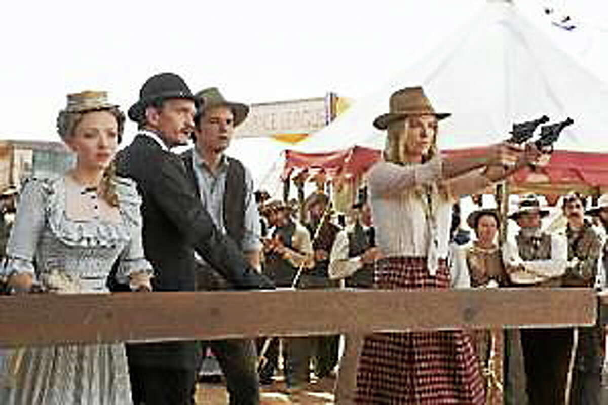 """Amanda Seyfried, Neil Patrick Harris, Seth MacFarlane and Charlize Theron in a scene from """"A Million Ways to Die in the West."""""""
