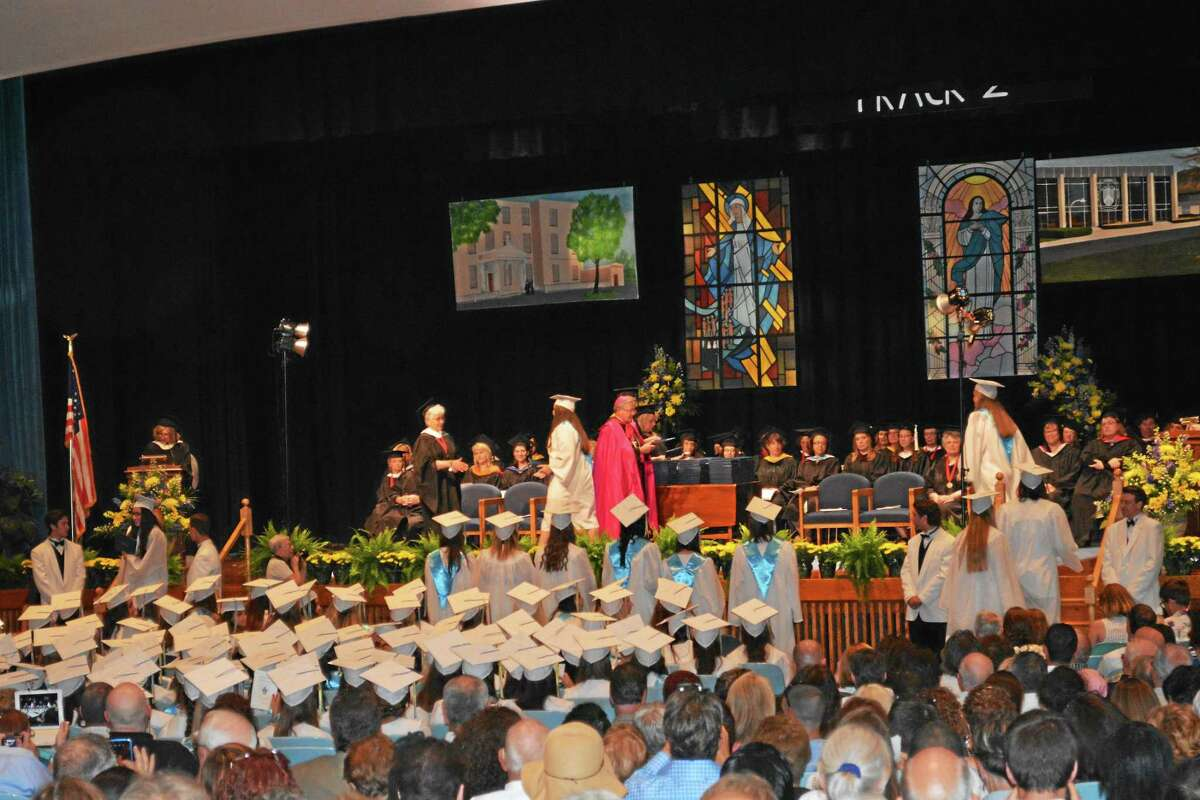 The newly minted young female graduates of Mercy High School receive their diplomas Thursday night.