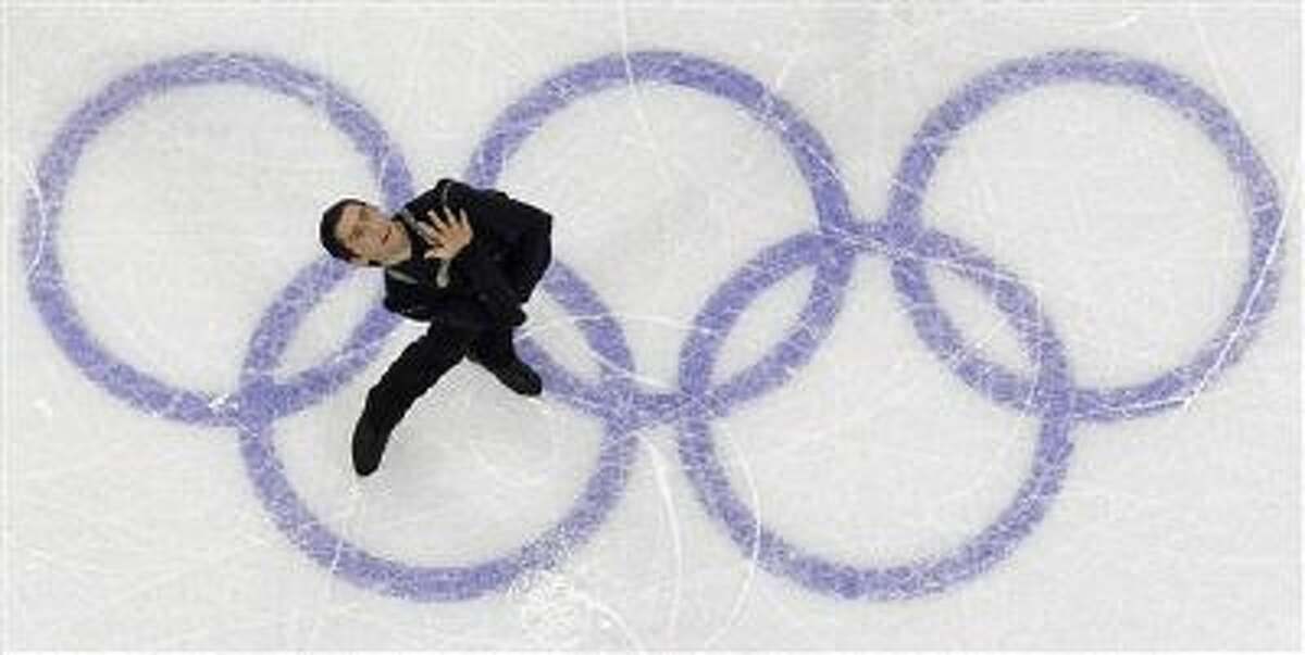 USA's Evan Lysacek performs his free program during the men's figure skating competition at the Vancouver 2010 Olympics in Vancouver, British Columbia, Thursday, Feb. 18, 2010.