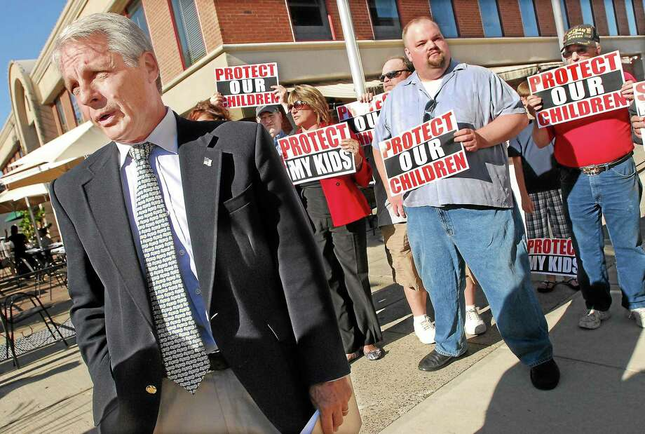 Former state Sen. Len Suzio, R-Meriden is seen in this 2012 file photo outside Middletown police headquarters. Photo: Middletown Press File Photo