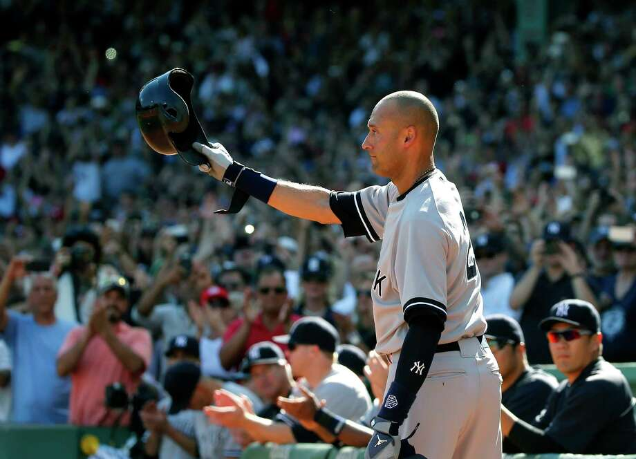Derek Jeter tips his cap to the crowd at Fenway Park after coming out of the game for a pinch-runner in the third inning Sunday in Boston. Photo: Elise Amendola — The Associated Press  / AP