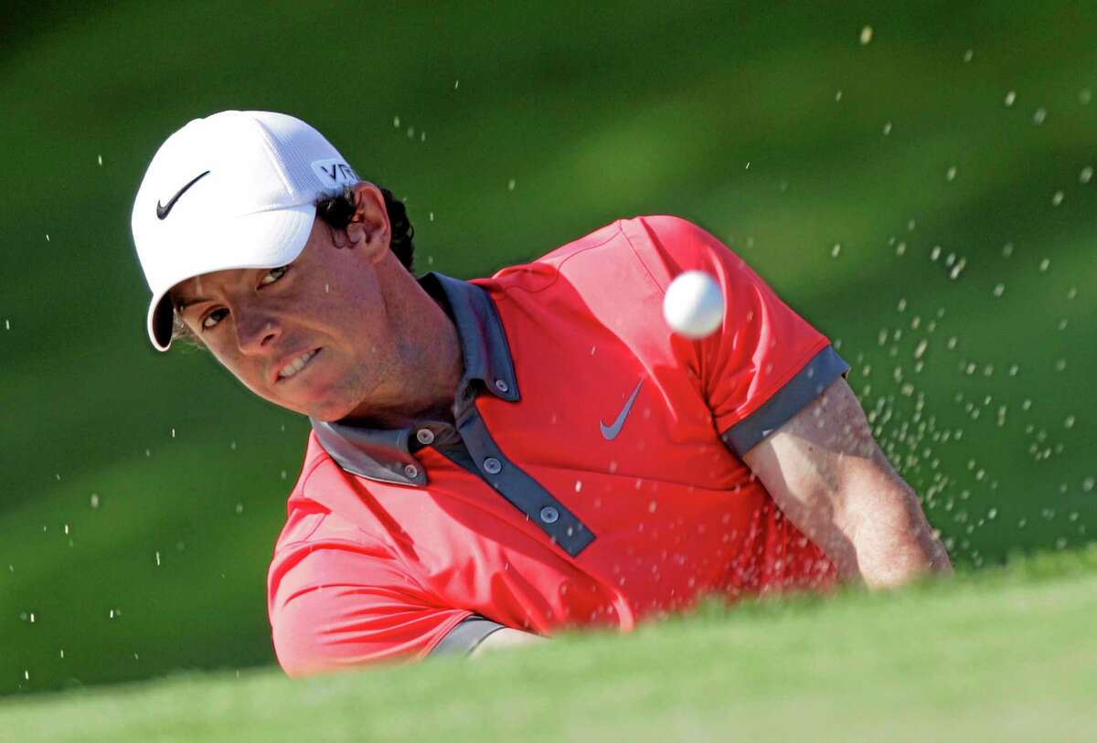 Rory McIlroy hits out of a bunker on the 18th hole during the first round of the Memorial on Thursday in Dublin, Ohio.