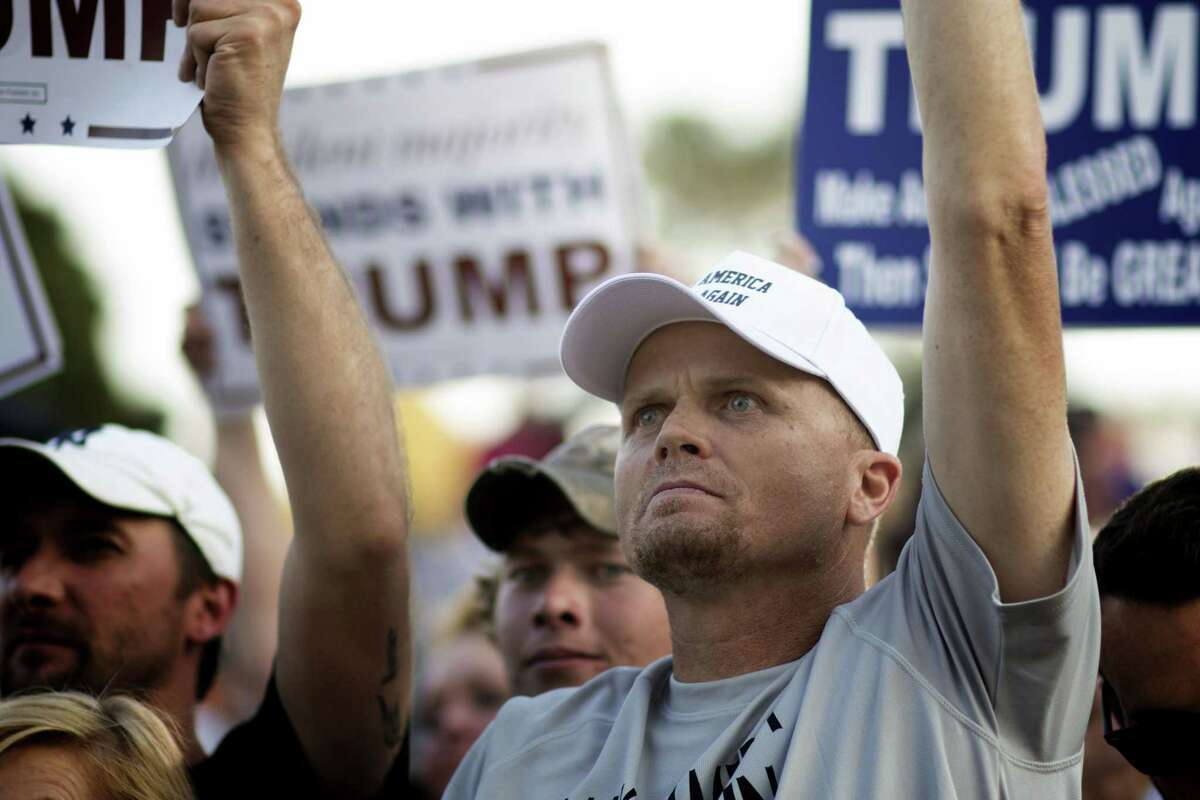 A man reacts as Republican presidential candidate Donald Trump delivers his message during a campaign rally at the state fair in Oklahoma City on Sept. 25, 2015.