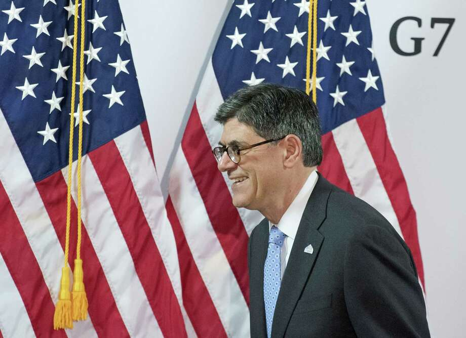 Jacob J. Lew, U.S. secretary of the Treasury, passes U.S. flags after a press conference at the G7 Finance Ministers meeting in Dresden, eastern Germany, Friday. Photo: Jens Meyer — The Associated Press  / AP