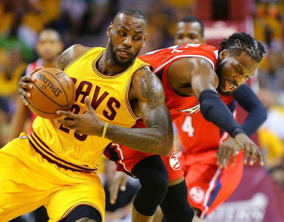 Cleveland Cavaliers LeBron James, left, and Hawks DeMarre Carroll battle for a loose ball during game four of the Eastern Conference Finals on May 26, 2015, in Cleveland.