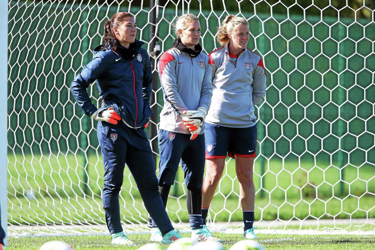 From left, goalkeepers Hope Solo, Ashlyn Harris and Seymour's Alyssa Naeher stand in goal during a United States Women's National Team training session at Swope Park Soccer Village in Kansas City, Missouri, on Oct. 14, 2014.