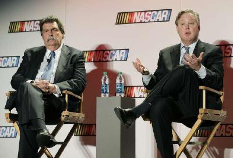 NASCAR CEO Brian France, right, speaks to the media as NASCAR president Mike Helton, left, listens during a news conference at the NASCAR Sprint Cup auto racing Media Tour in Charlotte, N.C., Thursday.