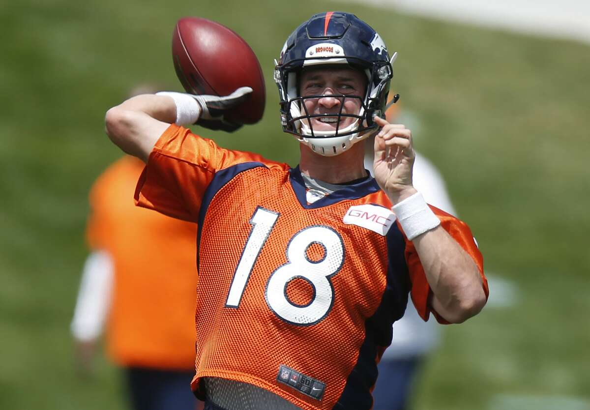 Denver Broncos quarterback Peyton Manning throws a pass during drills at an organized team activity on Wednesday in Englewood, Colo.