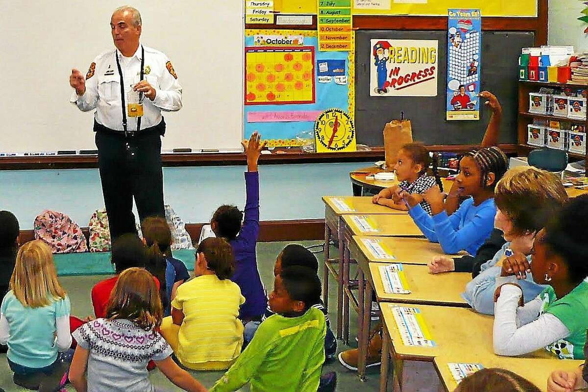 Fire Marshal Al Santostefano speaks to a group of school children in this undated Press file photo.