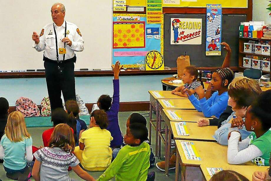 Fire Marshal Al Santostefano speaks to a group of school children in this undated Press file photo. Photo: Middletown Press File Photo