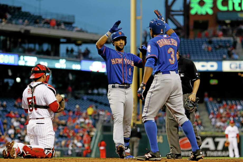New York's Chris Young, center, and Curtis Granderson, right, celebrate near Phillies catcher Carlos Ruiz after Young's two-run home run during the fourth inning of the Mets' 4-1 win on Thursday in Philadelphia. Photo: Matt Slocum — The Associated Press  / AP