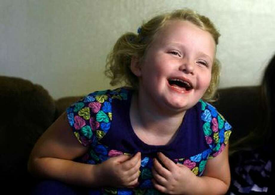 """""""Here Comes Honey Boo Boo"""" reality television personality Alana Thompson laughs during an interview at her home in McIntrye, Ga."""