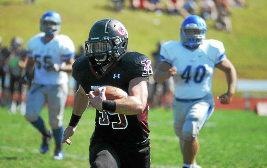 Valley Regional/Old Lyme senior Justin Cheverier races towards the end zone in the Warriors 42-7 win at Old Lyme. Photo: Jimmy Zanor — Middletown Press