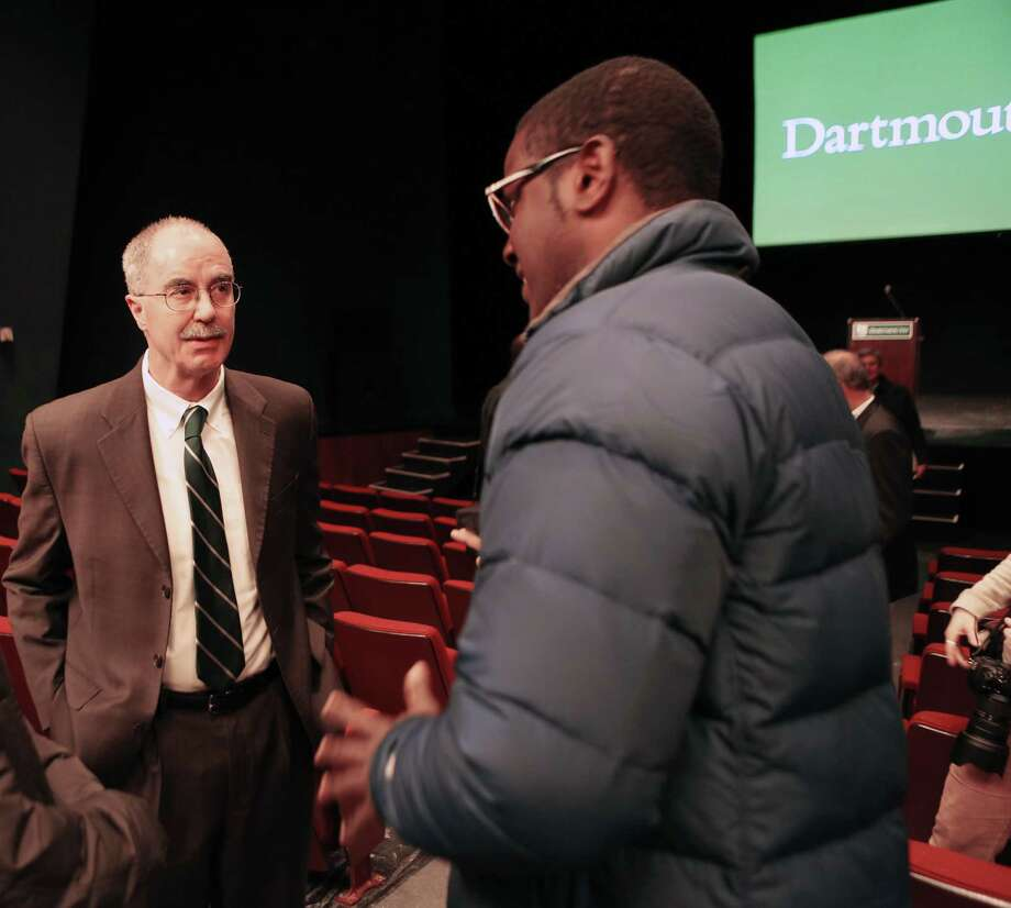 Dartmouth College President Philip Hanlon, left, speaks with a student after telling faculty and students about changes planned for the Ivy League school Thursday Jan. 29, 2015 in Hanover, N.H. Dartmouth College banned hard liquor on campus Thursday and said all students will have to take part in a sexual violence prevention program all four years they're enrolled at the Ivy League school. Photo: (AP Photo/Jim Cole) / AP