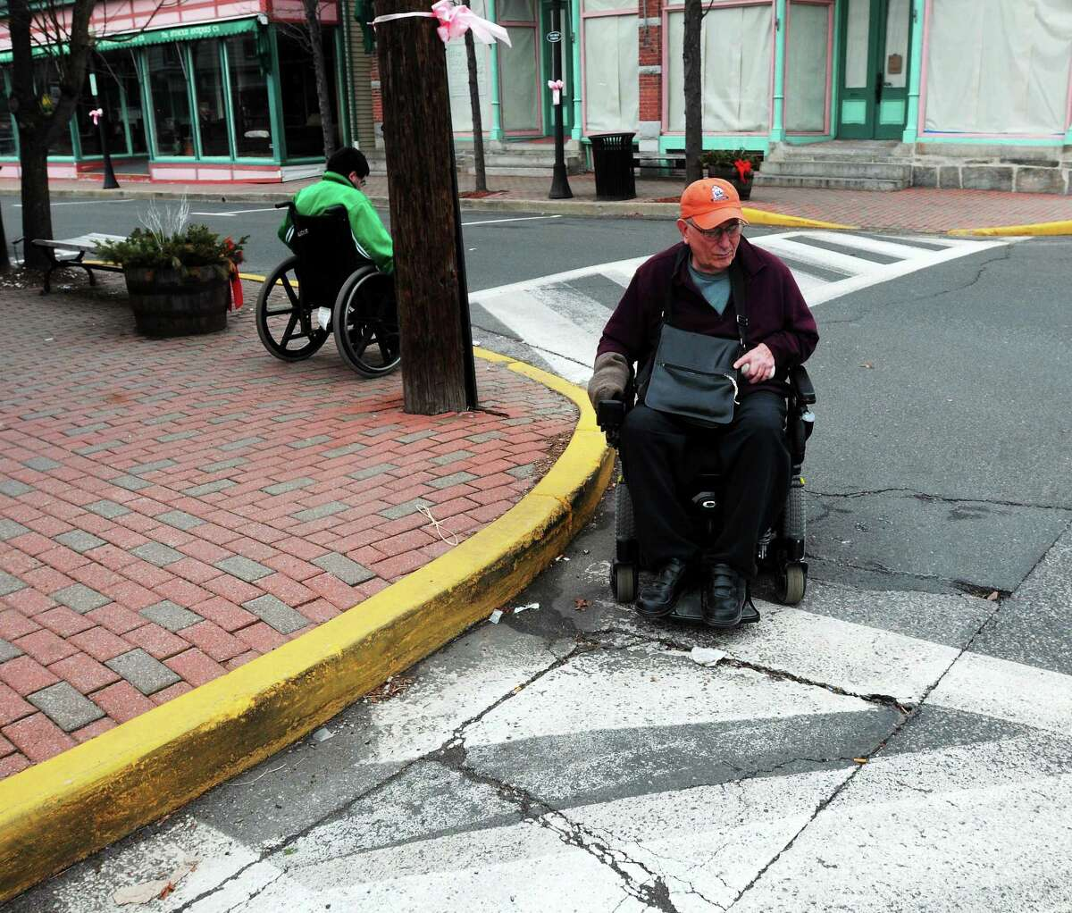 Kevin Galligan of North Branford and Joseph Luciano of Seymour deal with a crosswalk that has no curb cut to it in downtown Seymour in this January 2013 file photo.