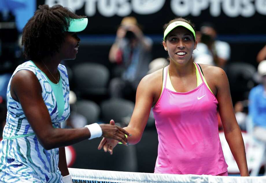 Madison Keys, right, is congratulated by Venus Williams at the net after winning their Australian Open quarterfinal match on Wednesday in Melbourne. Photo: Rob Griffith — The Associated Press  / AP